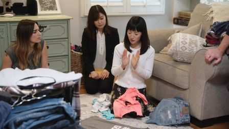 Marie Kondo, star of Tidying Up with Marie Kondo, thanks a piece of clothing for its service (C) Net