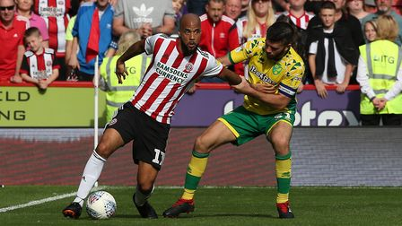 David McGoldrick up against Norwich City's Grant Hanley during the Championship match at Sheffield U