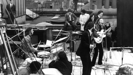 The Beatles performing their last live public concert on the rooftop of the Apple building in Savile