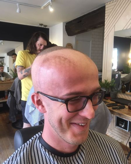 Tom Stevenson shaving his head during radiotherapy treatment following his second cancer diagnosis.