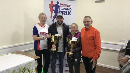 Race director Pat Brightman presents Ash Harrell and Faith Viney with their winner's trophies alongs