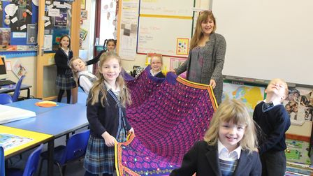 Mrs Yadav visited Year 1 children at Hethersett Old Hall School to show them objects from her travel