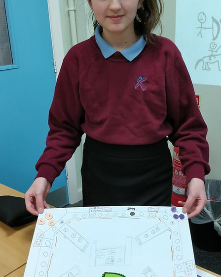 Year 7 students at Sprowston Community Academy with their 'Castle Attack' board games that include h