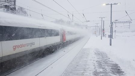 A Greater Anglia train in the snow. The Met Office said some rail services could be disrupted by sno