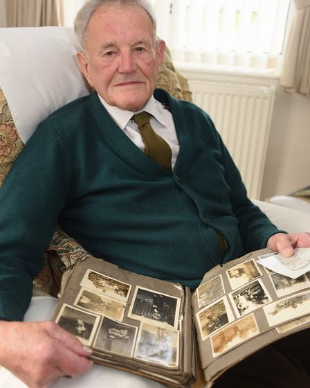 Colin Hunt with his old family photographs from when his family lived in Tottington before the area