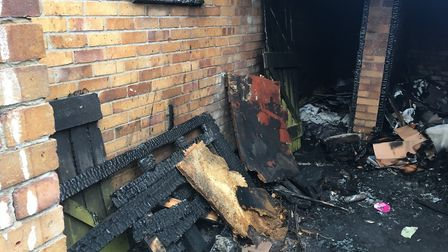 The remains of a fire which took place at the flats on Monday, December 31, since removed. Picture: