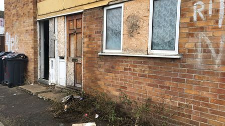 Pictured in January, the outside of the bottom floor flat, with the entrance to the block open to al