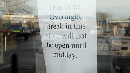 A sign telling cutomers the store will be closed after a break-in Picture: Chris Bishop