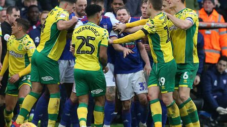 Norwich City captain Christoph Zimmermann, right, tries to calm tempers following Ipswich midfielder
