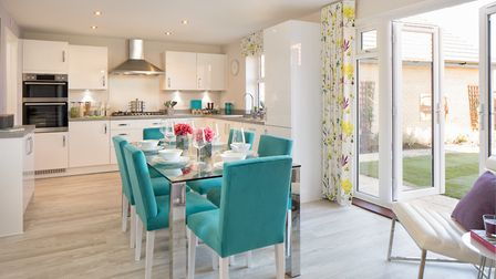 A kitchen and dining area in the popular new Clements Gate development. Picture: Christopher V Hadow