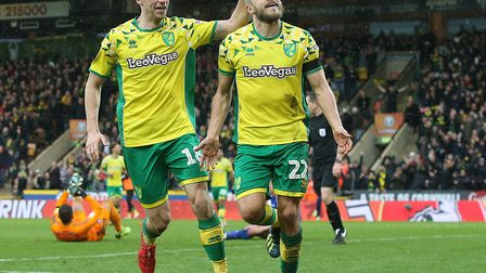 Teemu Pukki, right, is congratulated by Marco Stiepermann after scoring his 20th league goal of the