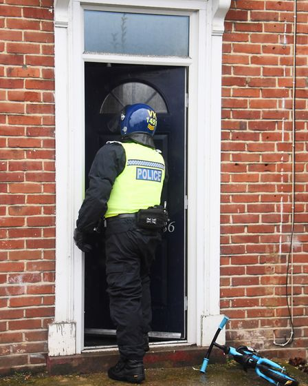 Police enter a property on the Aylsham Road during an Operation Gravity drugs raid. Picture: DENISE