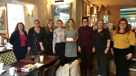 Founder of East Anglian Women in Business, Sarah Fairbrother, is holding the birthday cake at the fi