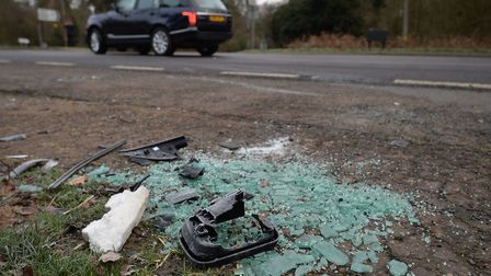Broken glass and car parts on the side of the A149 near to the Sandringham Estate where the Duke of