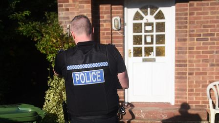 Police during an Operation Gravity drugs raid. Operation Gravity is Norfolk Police's response to cou