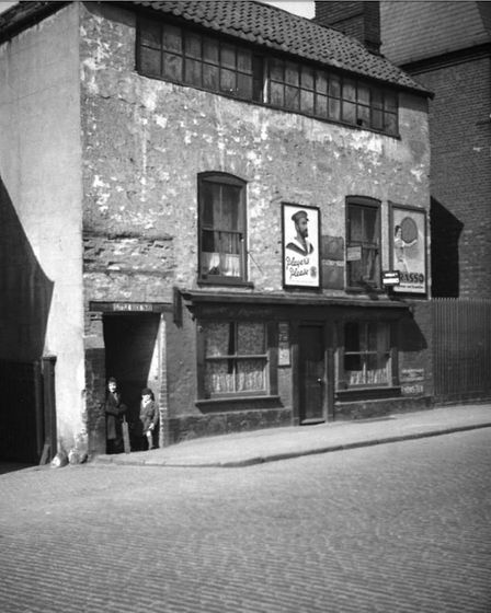 The entrance to Little Buck Yard, off Oak Street where maltings were, pictured in 1936. Picture: Geo