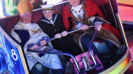 Nick Daubney, right, Mayor of West Norfolk, on the Waltzers with Bishop of Lynn, Jonathan Meyrick, a