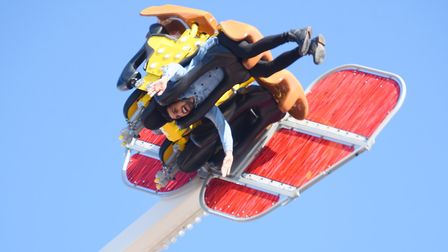 With a good head for heights, a thrillseeker rides one of the new rides at the 815th King's Lynn Mar