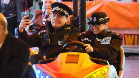 Police officers take a selfie on the dodgems at the opening of the 815th King's Lynn Mart. Picture: