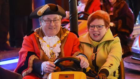 Nick Daubney, Mayor of West Norfolk, with his wife Cheryl, riding the dodgems at the opening of the