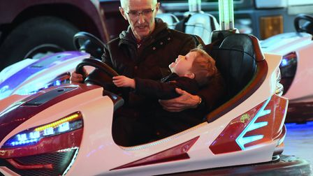 Three-year-old Sonny Sutherland, with his uncle, Sonny Thrower, on the dodgems at the 815th King's L