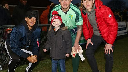 Denver Clinton with Norwich City footballers Jamal Lewis (left) and Todd Cantwell (right). Picture:
