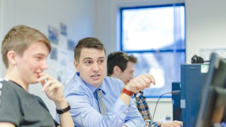 John Greenwood, head of the Develop EBP centre in Norwich, advises a student during a class. Picture