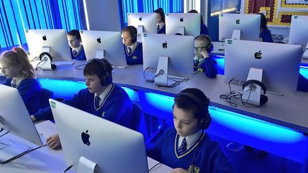 Pupils at Howard Junior School, in King's Lynn, learning in their iMac suite. Picture: Gregory Hill