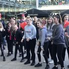 Dancers gather outside the forum for Norwich Rising, which is part of the international campaign One