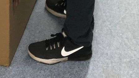 A pair of black Nike trainers Nick Sadler is thought to have been wearing when he went missing. Pict