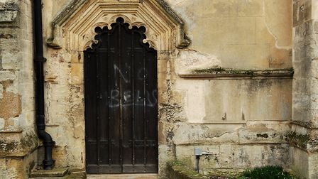 The door on the southern side of St Nicholas Chapel, in King's Lynn, which has been vandalised Pict
