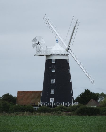 The tower windmill at Burnham Overy Staithe, which features on the village sign. Picture: DR ANDREW