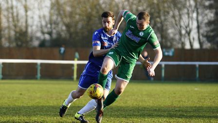 Lowestoft's Adam Tann keeps a grip on Biggleswade's Joe White Picture: Shirley D Whitlow