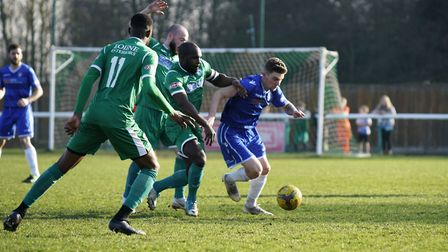 Lowestoft's Kyle Barker and Biggleswade Town player Kieron Forbes Picture: Shirley D Whitlow
