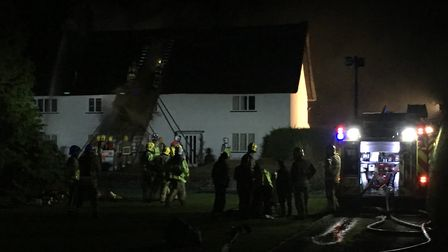 Emergency services attending a thatch fire in Mundham. Photo: Sabrina Johnson