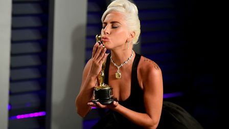 Lady Gaga with her Oscar for Best Original Song attending the Vanity Fair Oscar Party held at the Wa