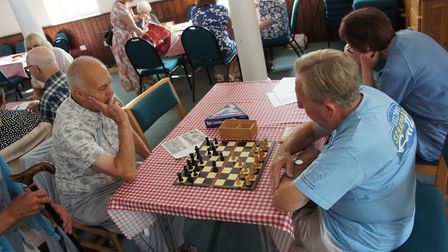 Members of the Wymondham Dementia Support Group play chess at a Monday morning Cafe. Photo: Phil Whi