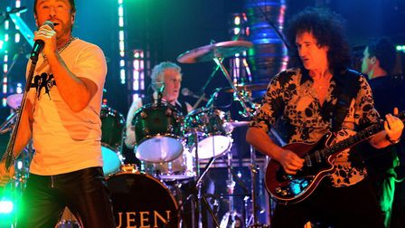 Brian May (right) and Roger Taylor (centre) of rock group Queen, with guest singer Paul Rogers (left