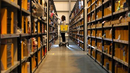 A worker picks orders at the Amazon UK Fulfilment Centre in Peterborough, Cambridgeshire. PRESS ASSO