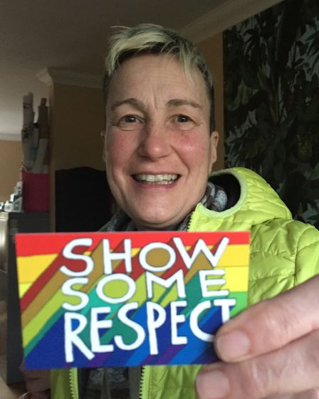Di Cunningham, organiser of the Proud Canaries holding up a Show Some Respect card. Picture: Proud C