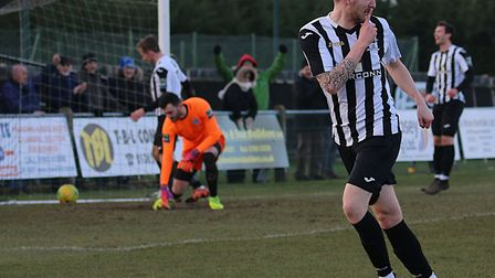 Even Dereham's Adam Hipperson can't keep the Magpies form quiet... Picture: Alan Palmer Photography