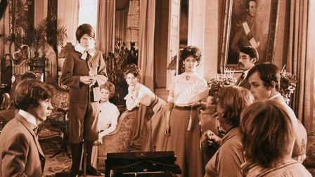 Julie Christie (centre pic, leaning on the chair) pictured during the filming of the Go-Between at M