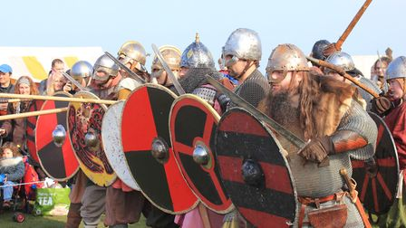 Re-enactors form a shield wall at the living history encampment set up at the Leas clifftop gardens