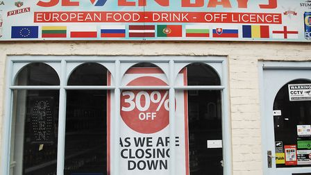 A sign says the Seven Days store is closing down Picture: Chris Bishop
