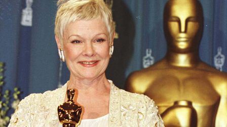 Dame Judi Dench with her Oscar at the 71st annual Academy Awards in Los Angeles, where she won Best