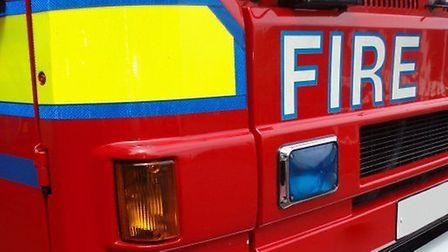 Fire crews from Norfolk and Suffolk were callede to a house fire in Yaxley. Picture: Phil King