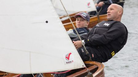 Tom Thwaites, 12, helming and winning his race, crewed by his father Matthew Picture: Sue Grief