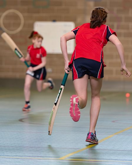 Schoolgirl runs during a game of cricket Picture: Steve Adams