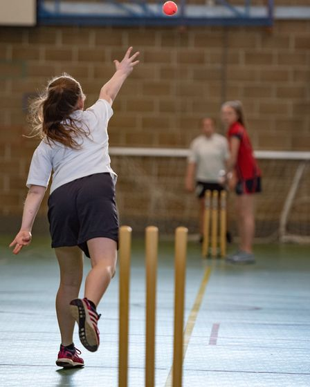 Schoolgirl bowls in a game of cricket Picture: Steve Adams