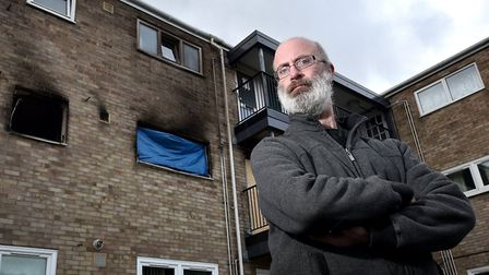 Robert Royal pictured at his former flat, on Penn Grove in Norwich, which was damaged by fire.Pictur